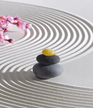 Feng shui piled rocks in zen sand pattern
