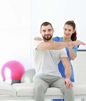 Kinesiology practitioner treating patient
