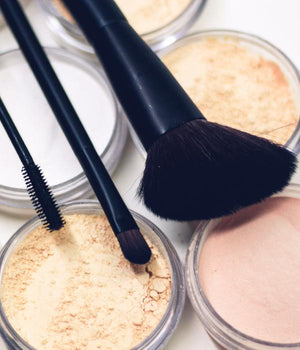 Assorted make up products and brushes