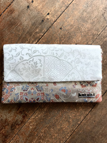 White and Silver Patterned Clutch