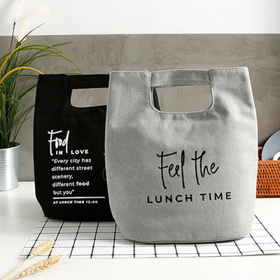blue and gray canvas women lunch bag for work on desk