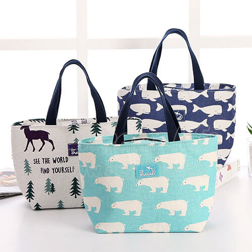 navy blue and blue fashionable women lunch totes on desk