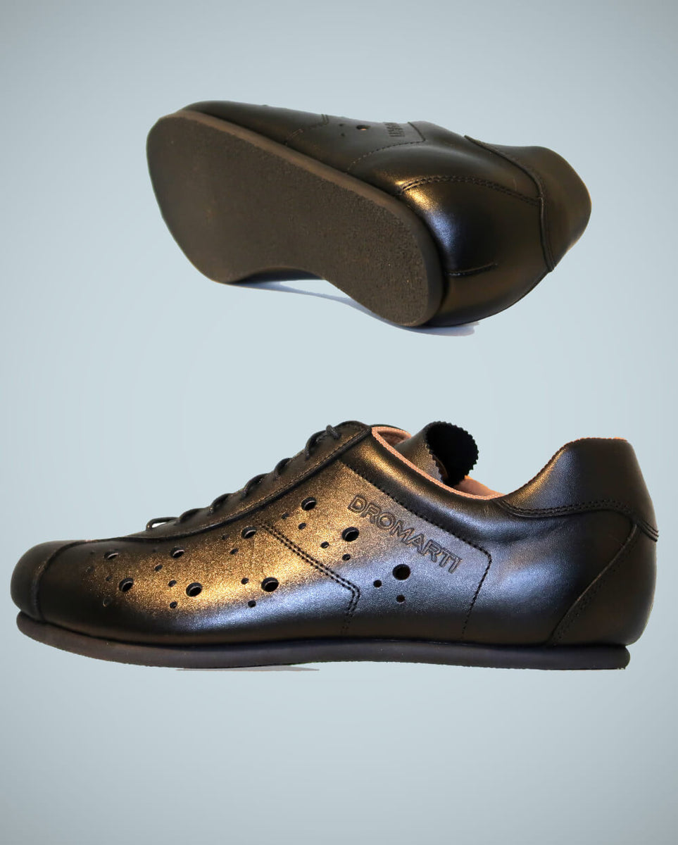Flat soled black leather cycling shoes. L'Eroica events with toeclips and straps.