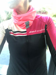 Flaming Pink snood and 2XU Cycling top on woman