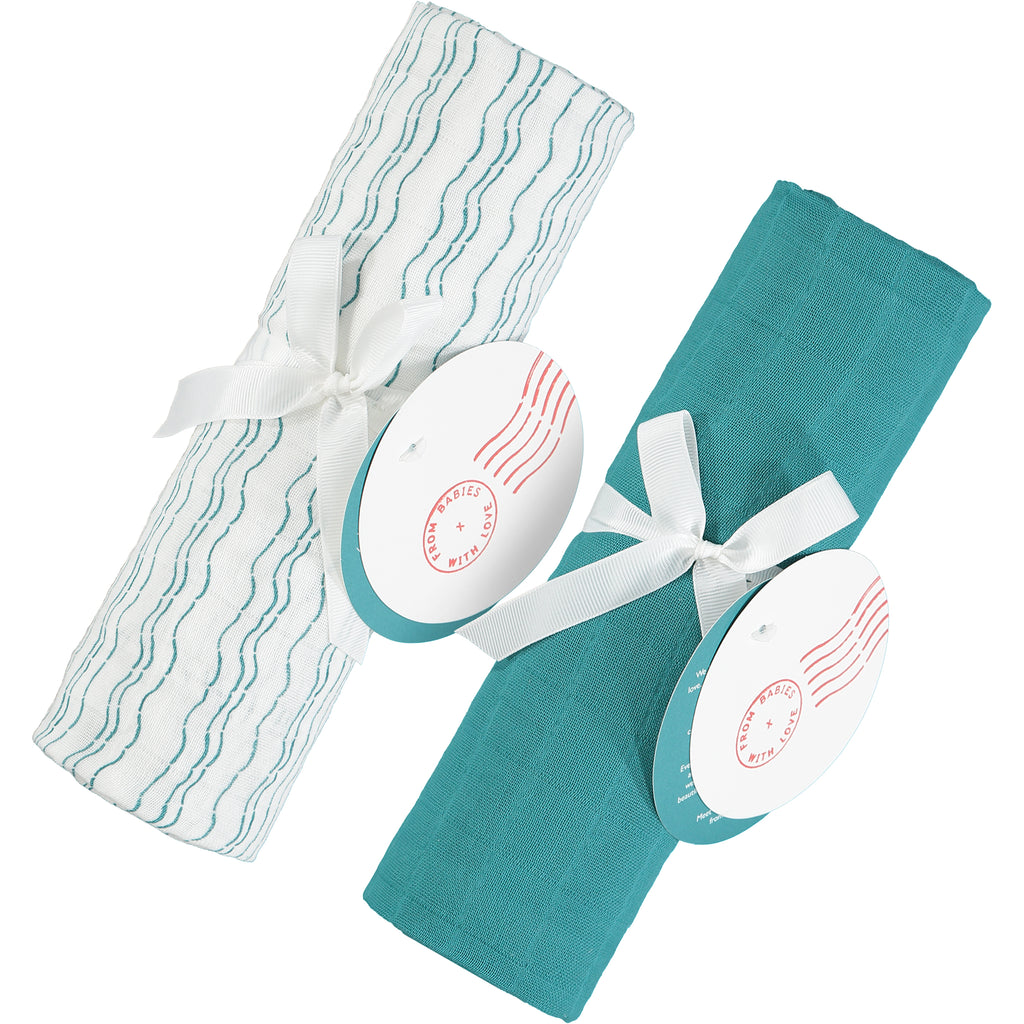 Send love and kindness with our Waves of Joy and teal organic muslin baby shawl + swaddling wraps, a heartfelt and beautiful baby gift.
