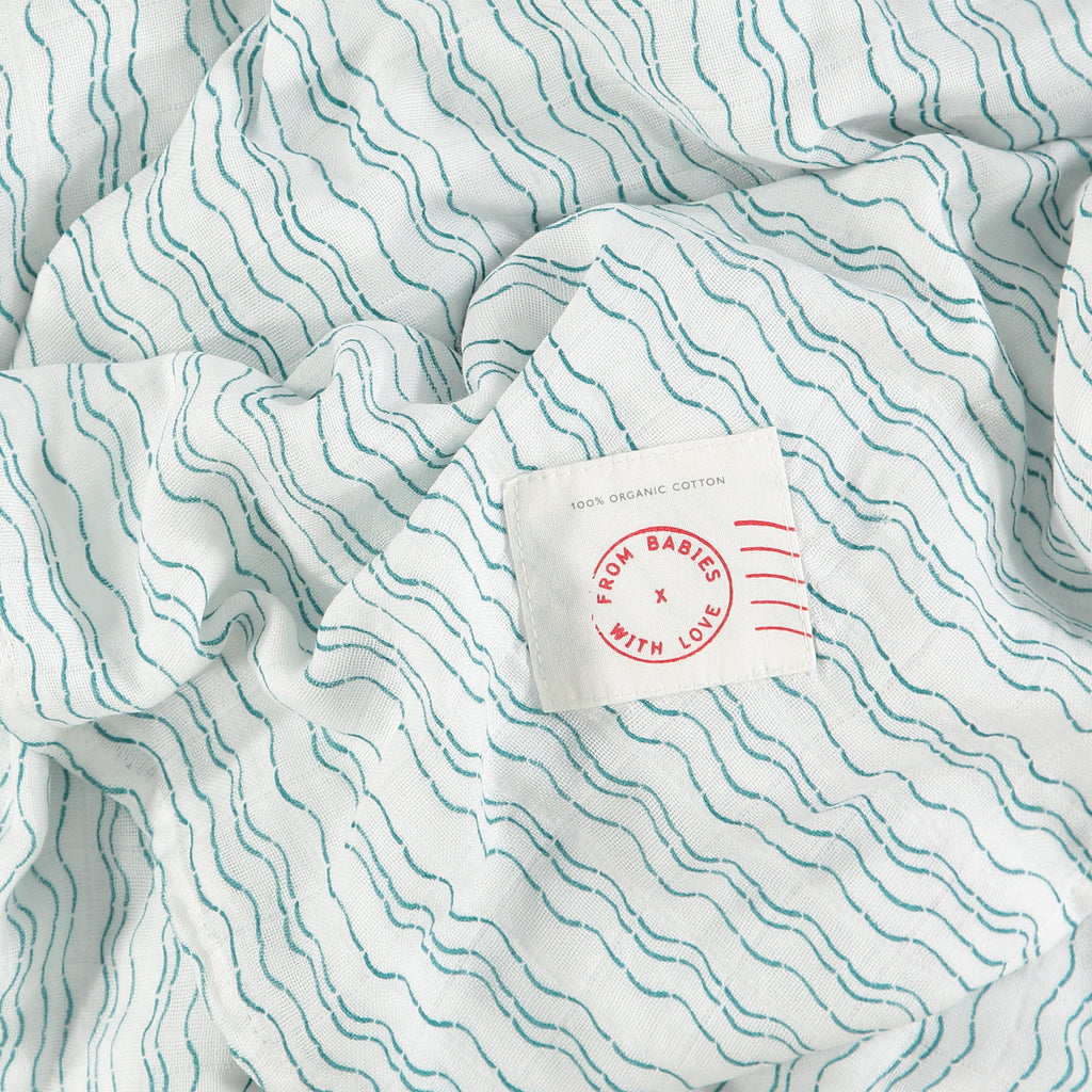 Waves of Joy organic muslin baby shawl - Send love and kindness with our Waves of Joy organic muslin baby shawl + swaddling wrap, a heartfelt and beautiful baby gift.