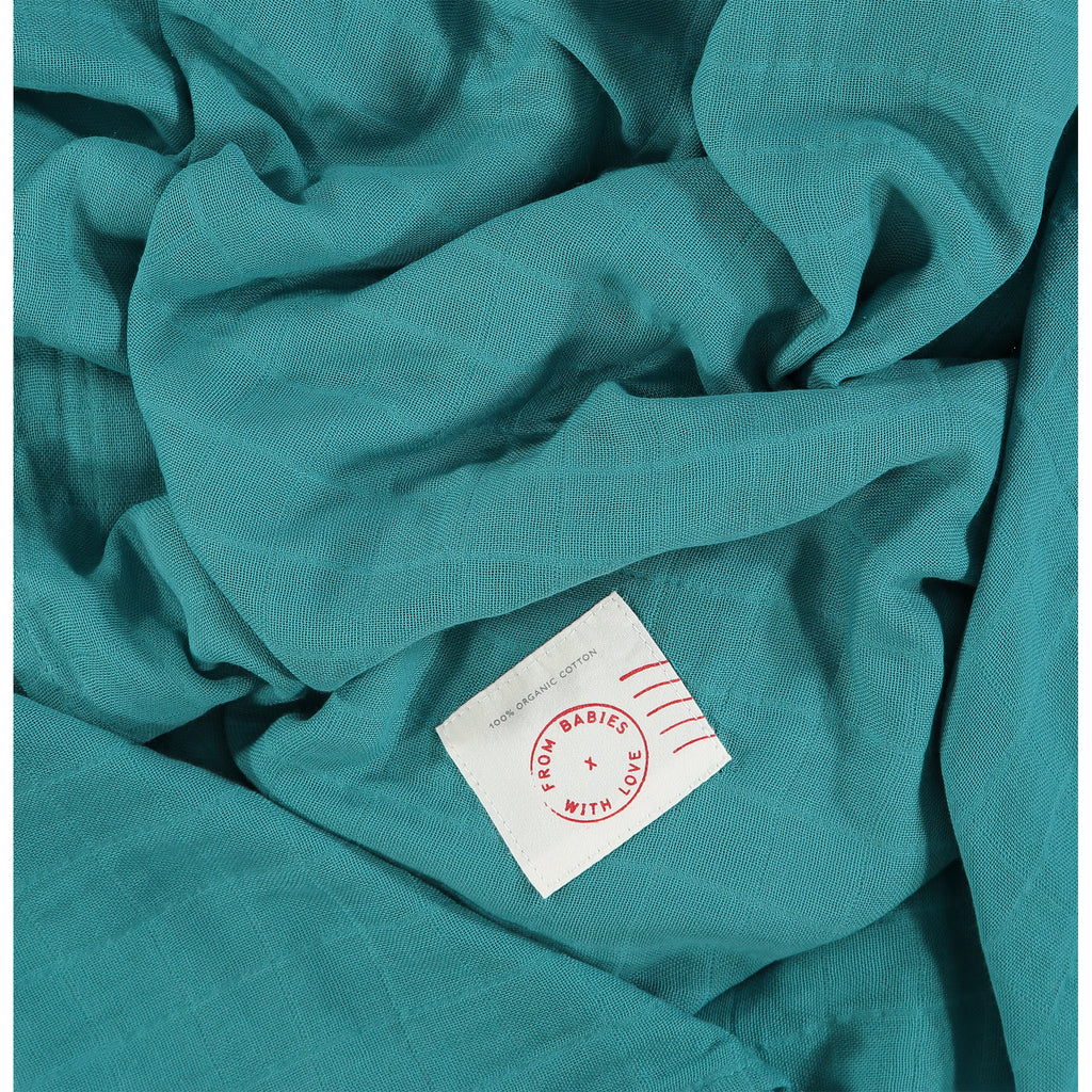 Teal - Send love and kindness with our Waves of Joy organic muslin baby shawl + swaddling wrap, a heartfelt and beautiful baby gift.