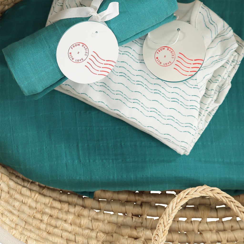 Baby basket - Teal organic baby gift set - large - Send love and kindness with our Waves of Joy organic baby grow, knot hat, bandana bib and muslin swaddling wrap, a heartfelt and beautiful baby gift.