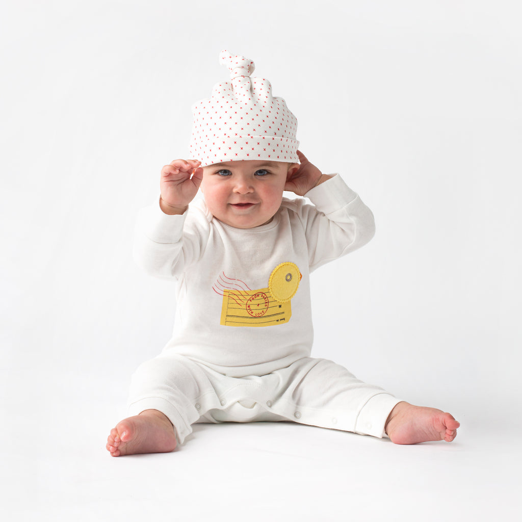 Red Little Kisses Baby Grow Made From 100% Organic Cotton. Free Drawstring Gift Bag and Greetings Card with All Profits To Abandoned Children.