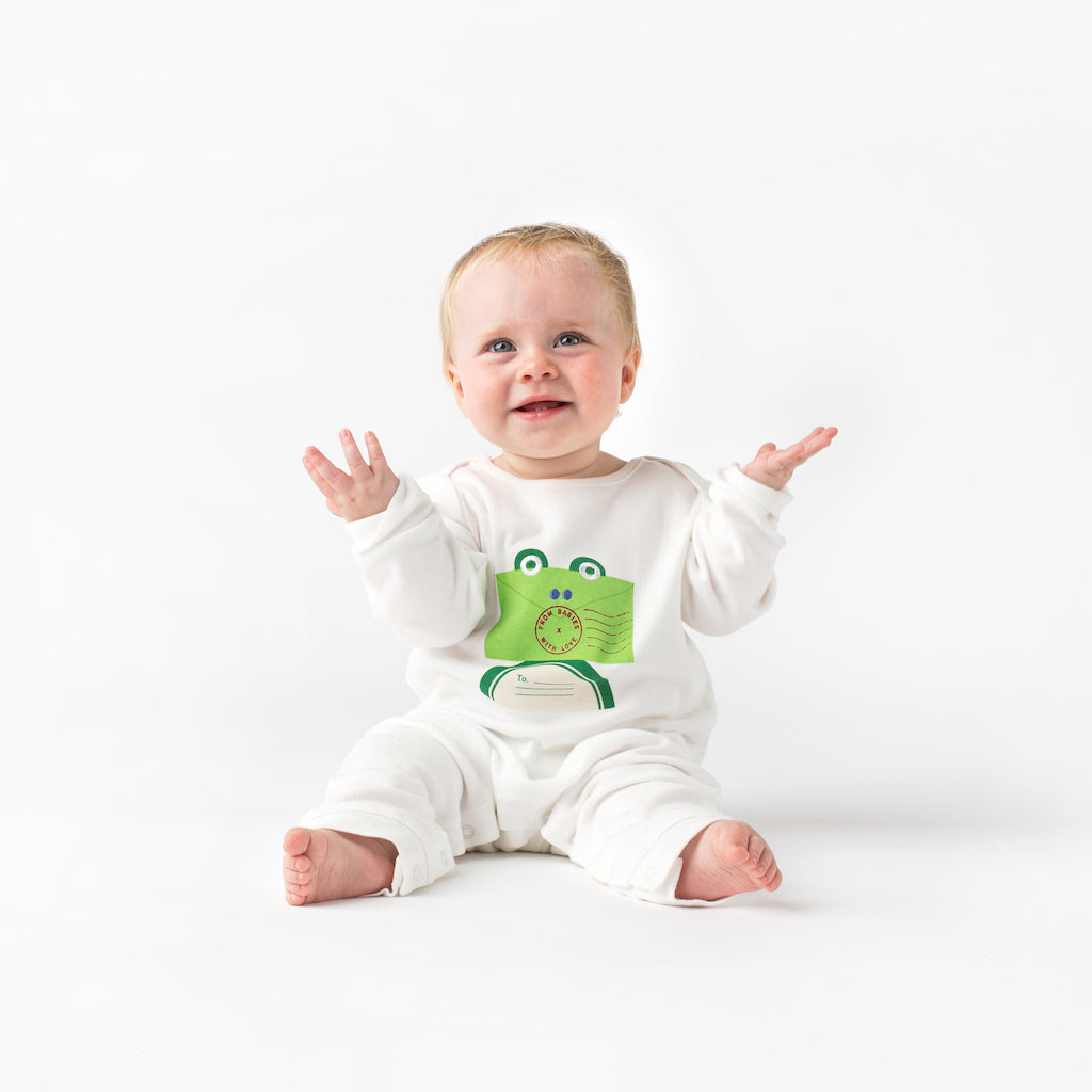 Lifestyle - Frog and Kisses Baby Grow and Knot Hat Gift Set. With Complementary Greetings Card and Drawstring Gift Bag.