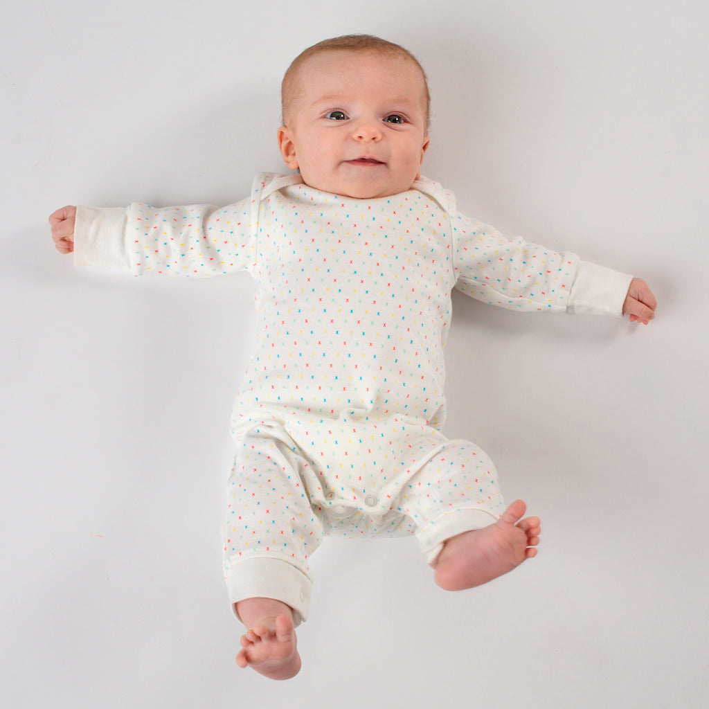 Gender Neutral and Unisex Organic Baby Grow With Multi-Coloured Kisses Design: Cute Baby Image