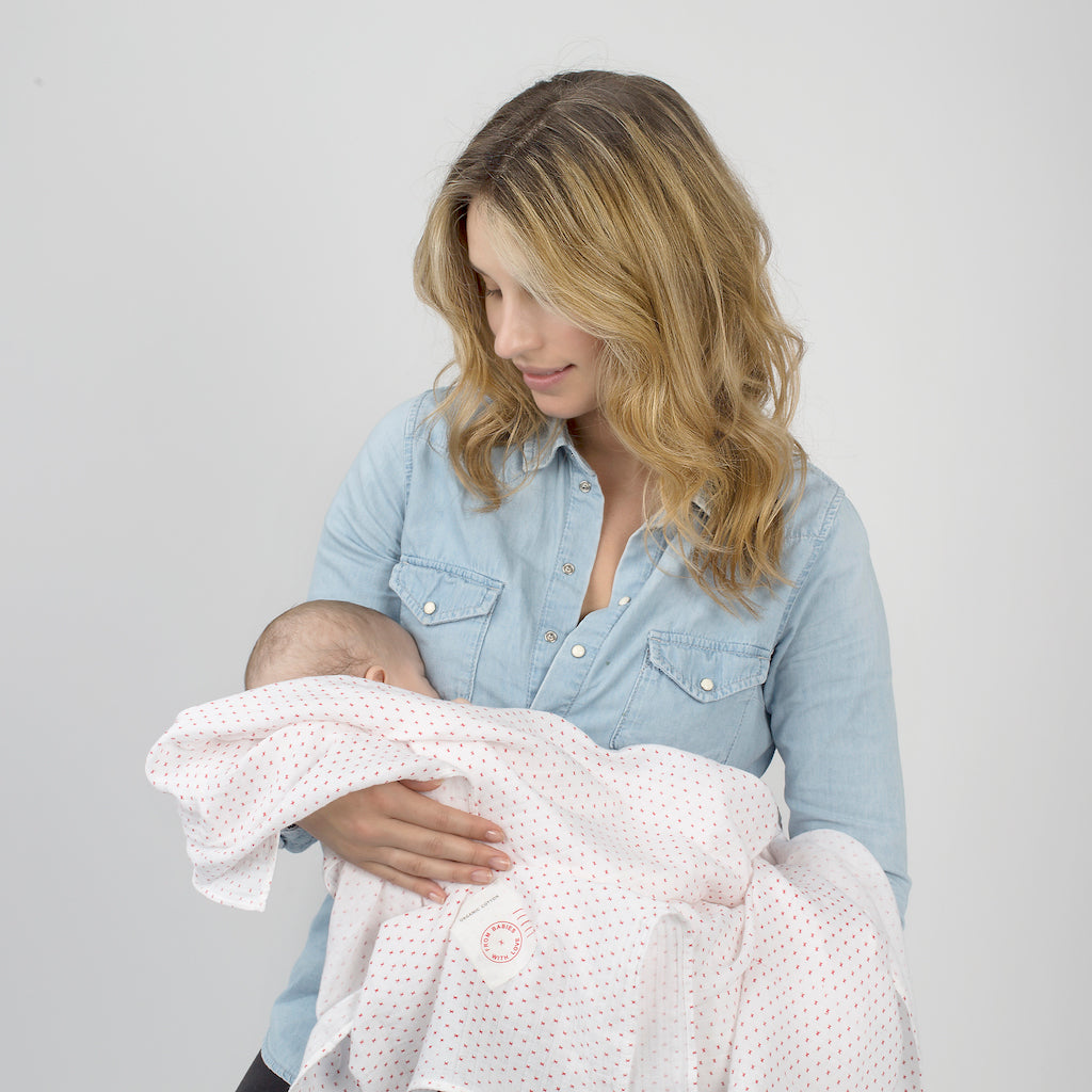 Lifestyle - Red Kisses Muslin Swaddle Made From 100% Organic Cotton. Free Drawstring Gift Bag and Greetings Card with All Profits To Abandoned Children.