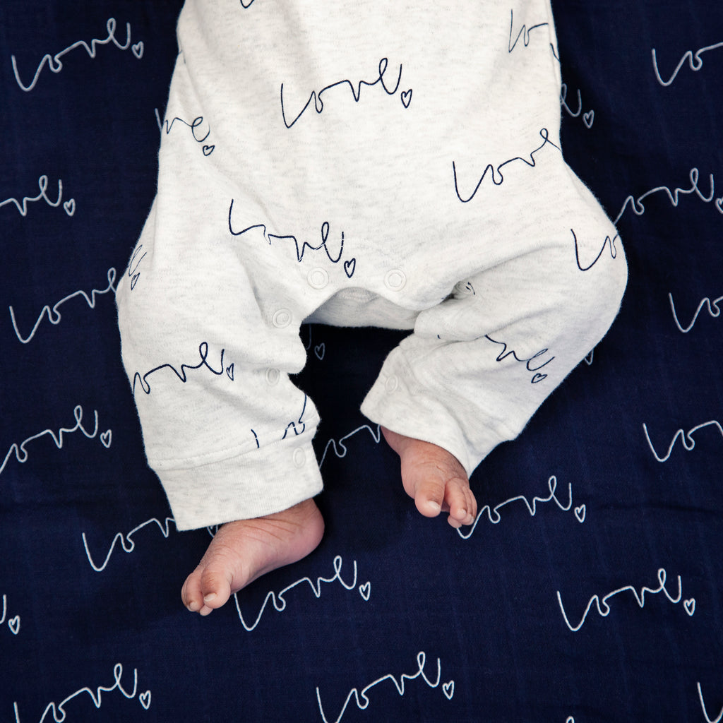 Baby toes - Our love multi-print organic baby grow is made with luxuriously soft organic cotton; give the gift of love!