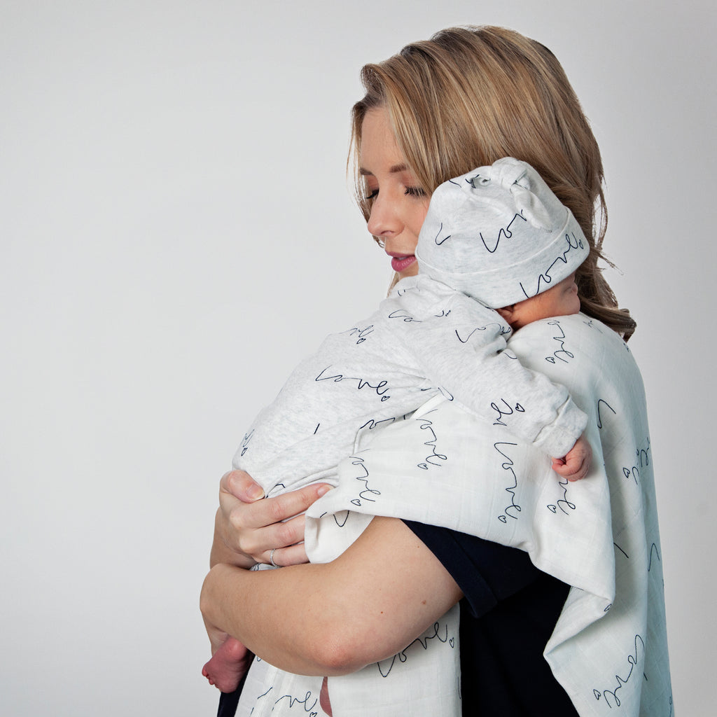 Lifestyle - Our love multi-print organic baby grow is made with luxuriously soft organic cotton; give the gift of love!