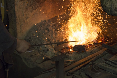 Blacksmith forge with iron in the fire.