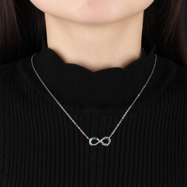 silver infinity necklace featuring model