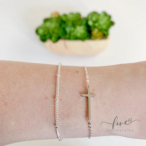 silver sideways cross, dainty, minimalist, layering bracelet, made in the usa, handmade, boutique in homer glen illinois