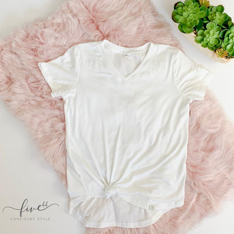 white tee shirt, fair trade, v neck, flat lay with pink fur rug, online boutique, Five44