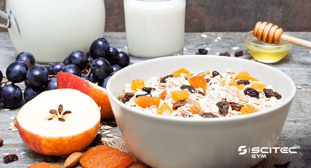A balanced and healthy breakfast consisting of milk, fruits, muesli and honey