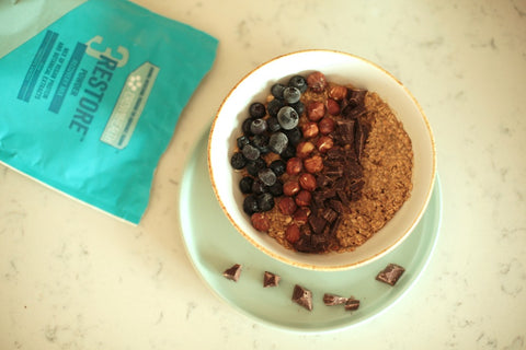 Restore Powder recipe for recovery after workout with oats meal, blueberries, nuts and chocolate