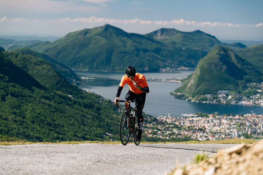 biking with view of lugano lake switzerland with crownhealth vegan nutrition sports suit