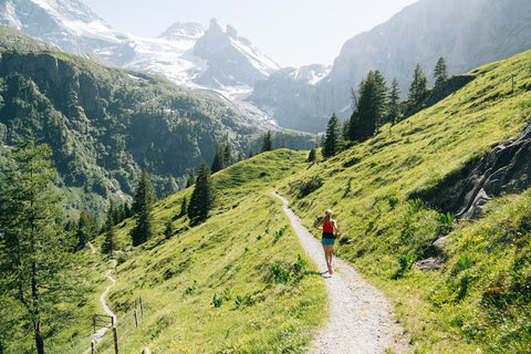 solo runner training on the swiss alps with mountain view
