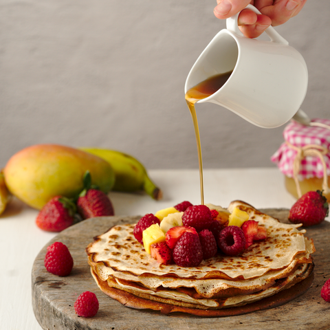 whole wheat crêpes with fruit and maple syrup