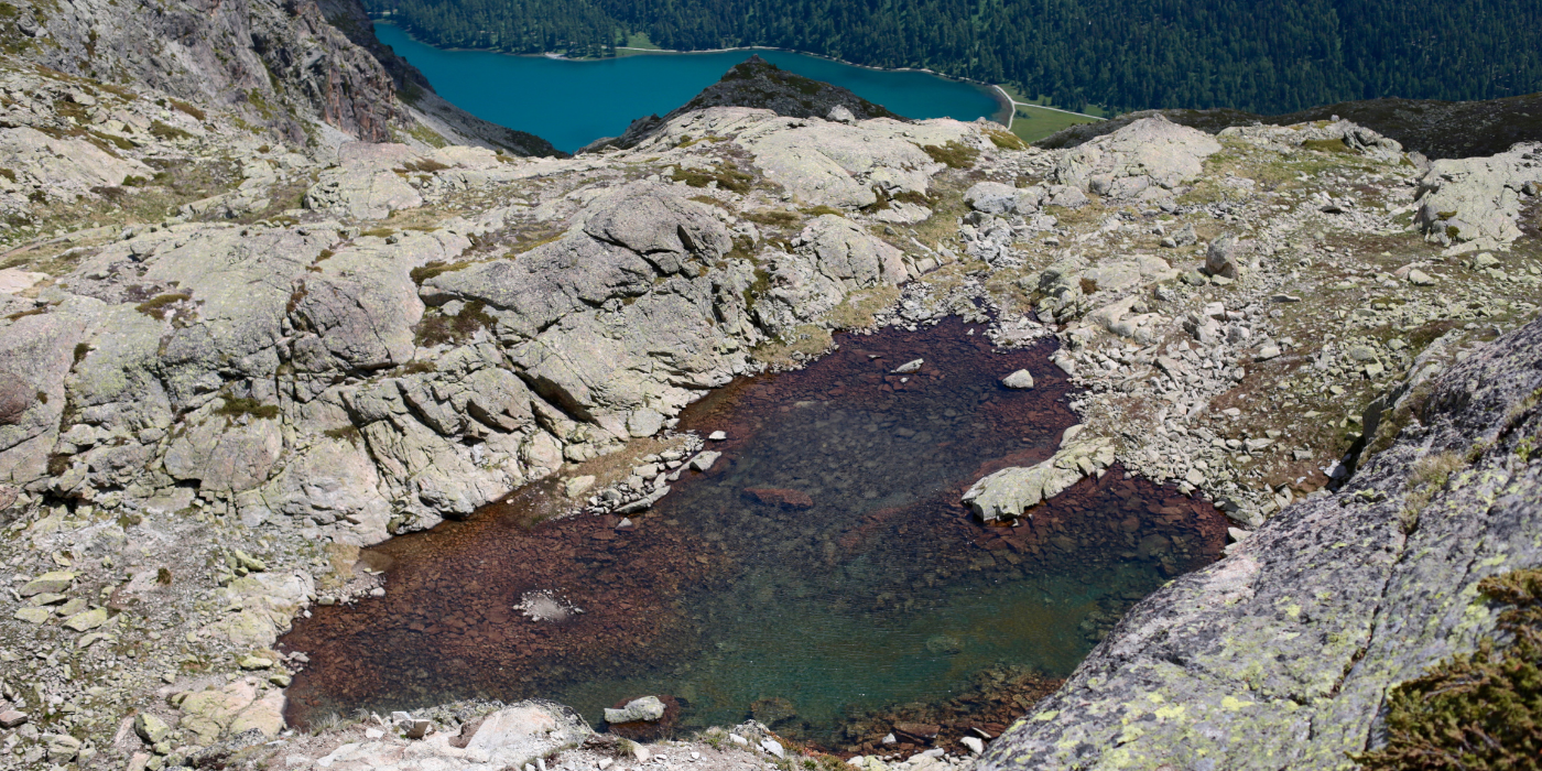 heart shaped alpine lake on swiss mountains with its crystal clear water