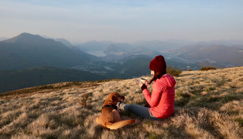 Simona Ino, Crownhealth co-founder, in the mountains with his dog Fiona