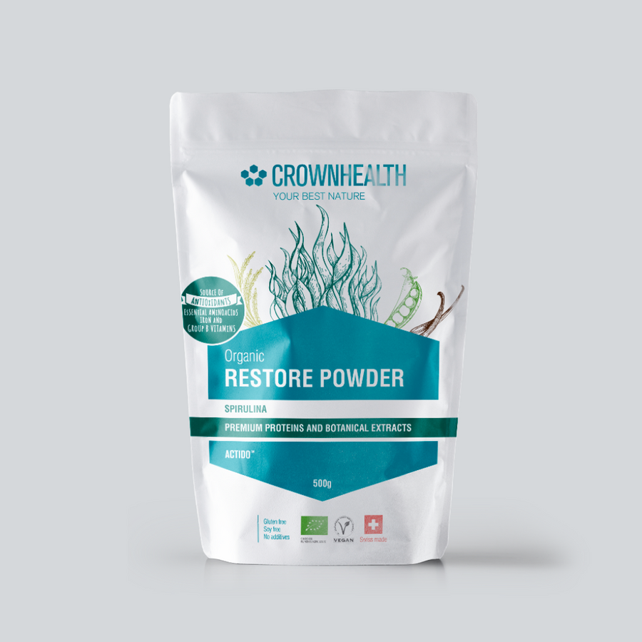 "Premium proteins and botanical extracts support muscle repair and growth. Crownhealth Restore Powder Hemp in a white standing 500g pouch , with colurful ingredients draws. Blue Crownhealth logo and designs. A light green circle saying: ""I'm not just a protein powder,I'm a complete recovery mix!"". Quality logos like organic certified, vegan, gluten free, soy free , no additives and swiss made"