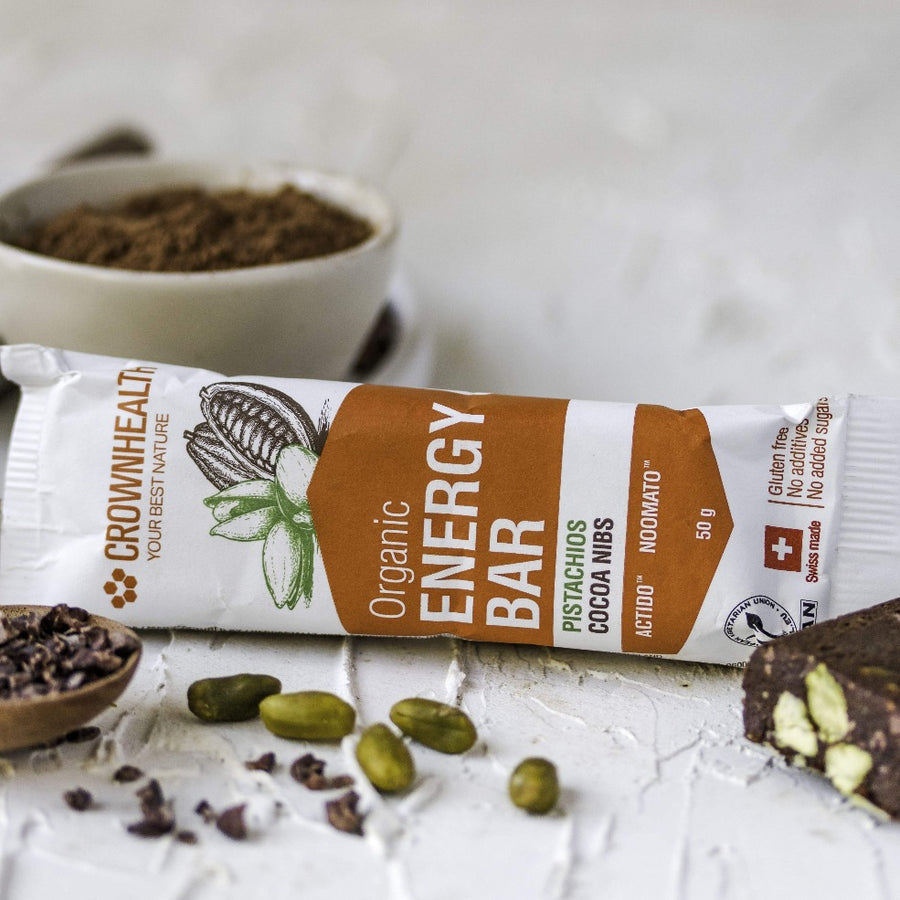 Cocoa, cocoa nibs, pistachios. On the go healthy real food always with you.The perfect energy snacks for your productive days. vegan organic energy and protein bars are a perfect everytime snack when walking, trekking, hiking, studying and working.