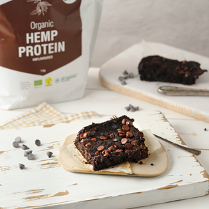 Yummy vegan high protein double chocolate keto brownies with chocolate chips, powered by organic hemp protein. Create delicious plant based recipes with plant proteins to kick off your day.