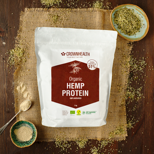 Crownhealth Vegan Organic Hemp Protein 1kg bag on wooden table with ingredients, hemp seeds and protein powder. free from gluten, additives, allergens, soy, these unflavored and all-natural plant-based protein mixes in powder are the ideal support for your general wellbeing. They provide your body only with premium quality vegan proteins. High quality vegan proteins boost your body fitness, and are packed with all essential BCAAs that support muscle mass growth, maintenance and repair. control hunger