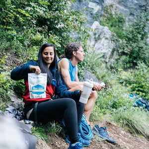 Couple of climbers are enjoying their protein rich recovery shake after climbing. Restore Powder Hemp is rich of anti-oxidant and perfect complete recovery shake after every mountain climbing
