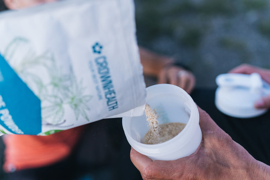 Couple of MTB bikers are enjoying their protein rich recovery shake on a top of a moutain.Restore Powder Hemp is rich of anti-oxidant and perfect complete recovery shake after every mountain bike journey