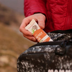 closeup organic energy bar during hiking on swiss mountains