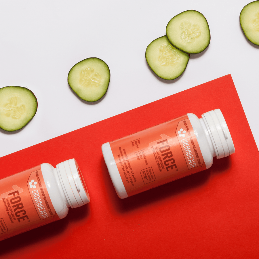 two bottles of force botanical supplement for tendons, muscles and joints with slices of cucumber, known for its anti-inflammatory effect