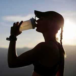 girl drinking a protein shaker after running workout. Crownhealth multi-functional eco-friendly shaker with blenderball for sports nutrition