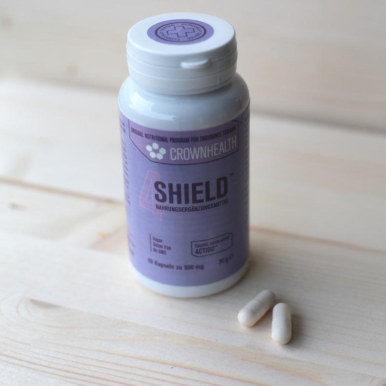 pack of shield with vegan probiotic pills on a table