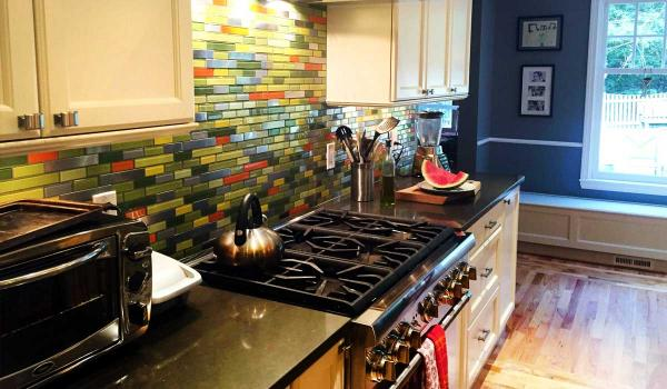 Steel Bamboo Remix With Orange, Yellow, and Grey Glass Tile Kitchen