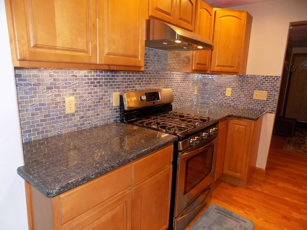 Eye popping kitchen with iridescent blue tile