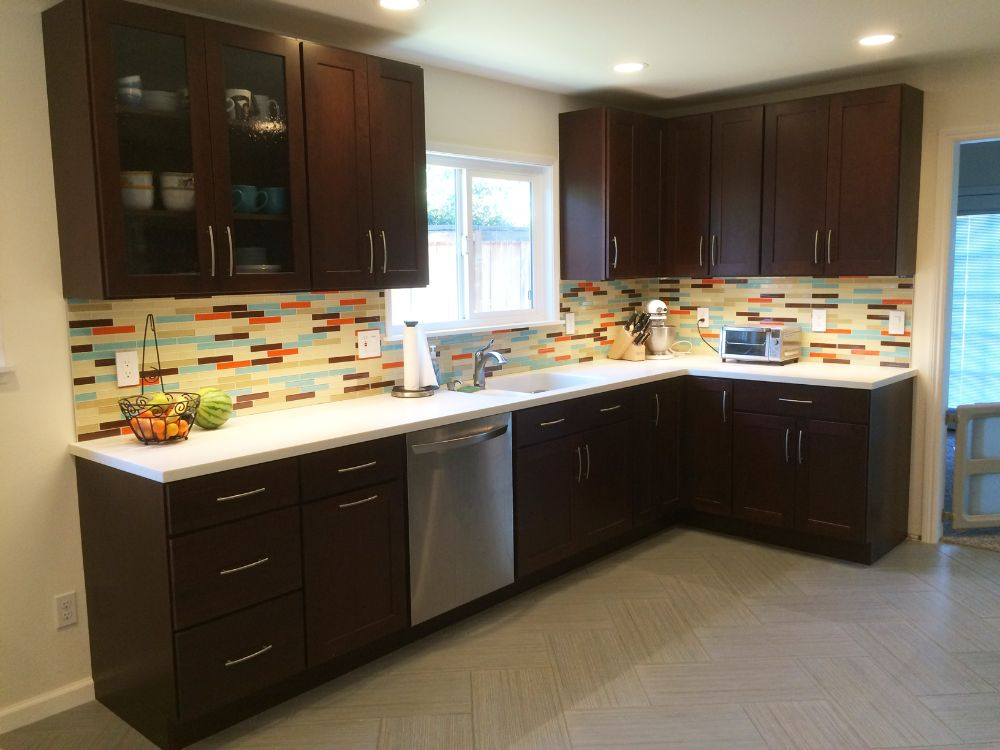 Colorful kitchen with custom subway glass tile