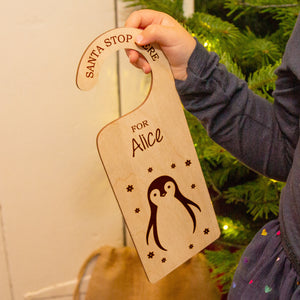 'Santa Stop Here' Personalised Penguin Door Hanger