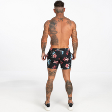 Load image into Gallery viewer, FLORAL SWIM SHORTS