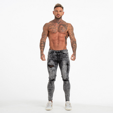 Load image into Gallery viewer, RIPPED SKINNY JEANS GREY WORN