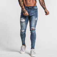 Load image into Gallery viewer, RIPPED SKINNY JEANS FADED BLUE