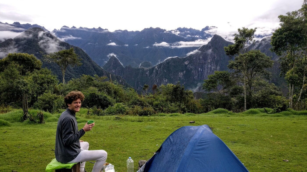 Preparing cacao with a view on Machu Picchu