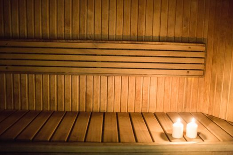 a sauna with candles