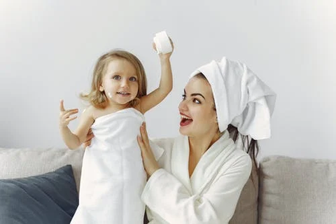 a mother and daughter in bathrobes