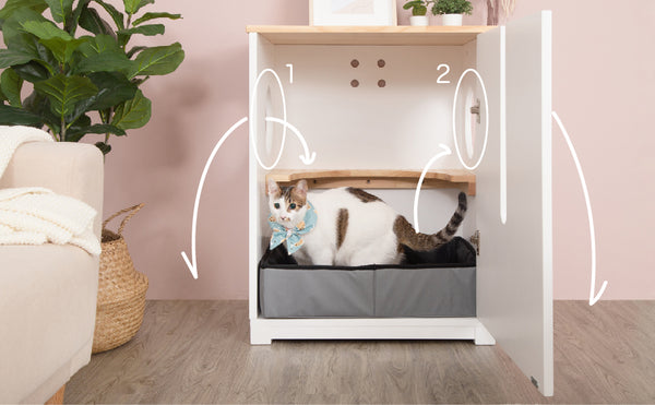 A white feline sitting in a large enclosure cat litter cabinet which includes two entry.